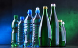 Different sorts of bottles containing mineral water - 246385284