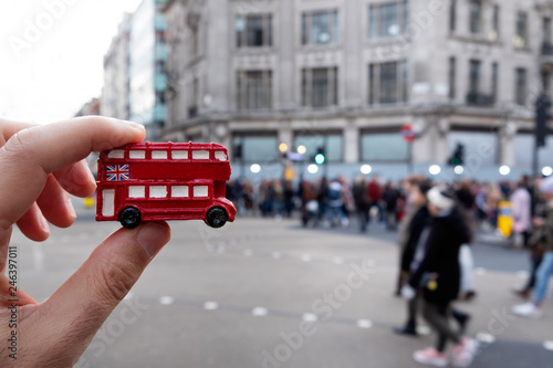 man with a londoner red double-decker bus