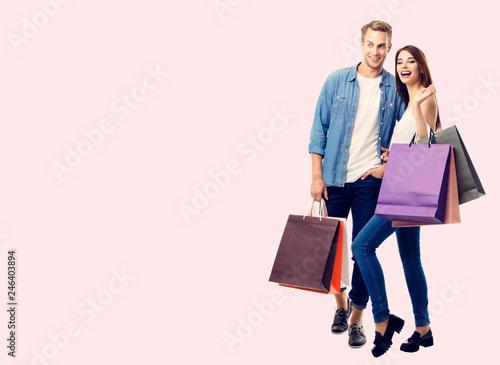 Leinwandbild Motiv happy couple with shopping bags