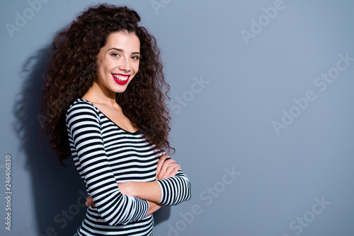 Leinwandbild Motiv Profile side view portrait of her she nice-looking cute charming attractive lovely cheerful cheery wavy-haired lady in striped pullover isolated over gray pastel background