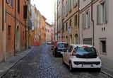 the narrow street in italian city Modena