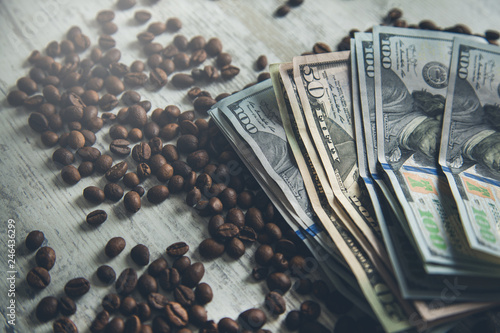 money on coffee beans on table