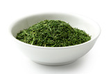 Dried chopped dill in white ceramic bowl isolated on white. - 246448409