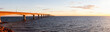 Panoramic view of Confederation Bridge to Prince Edward Island during a vibrant sunny sunrise. Taken in Cape Jourimain National Wildlife Area, New Brunswick, Canada.