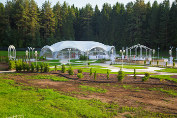 Photo of the beautiful white wedding pavilion among forest