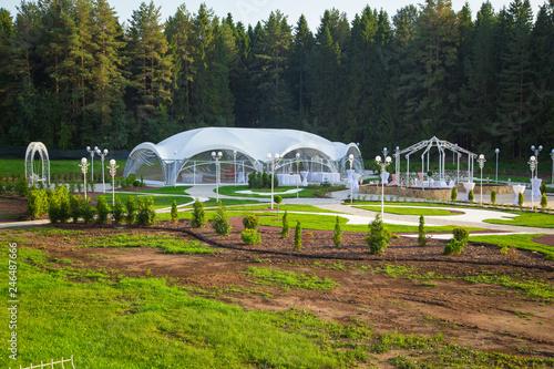 Photo of the beautiful white wedding pavilion among forest