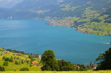 View of mountain lake with sailing boats in Switzerland
