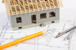 House under construction and accessories for drawing on electrical diagrams for project, building home concept
