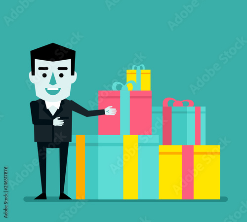 Cheerful Businessman Points To Stack Of Gift Boxes Birthday