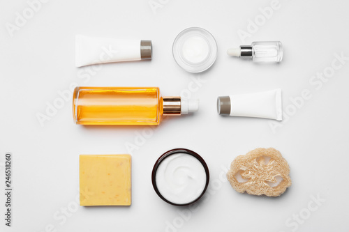 Leinwanddruck Bild Flat lay composition with body care products on white background