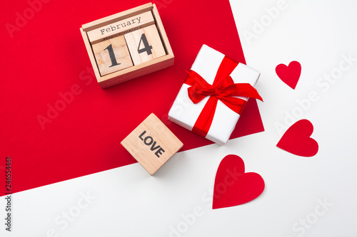 fototapeta na ścianę Valentines day greeting card. gift box on red table. Top view with copy space