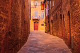 San Gimignano, Tuscany, Italy old medeival street in typical Tuscan town, popular tourist destination