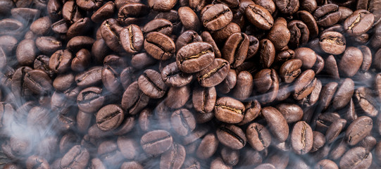 Roasted coffee beans. Food and drink background. Top view. © volff