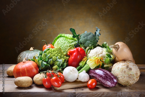 Fresh vegetables on rustic background, space for text