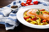 Pasta with grilled salmon and vegetables - 246660061