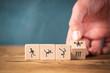 Leinwandbild Motiv Icons on cubes symbolizing sports on wooden background