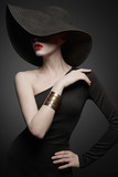 portrait of young lady with black hat and evening dress - 246672413