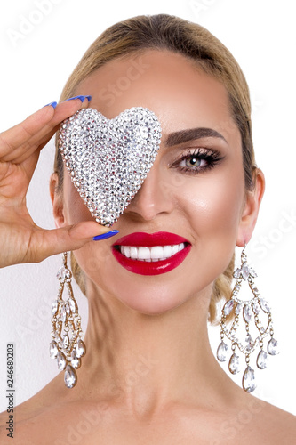 Valentine Beauty girl with silver heart jewelry and in elegant makeup isolated on white background. Beautiful Happy Young woman with white teeth. Joyful jewelry and makeup model - 246680203