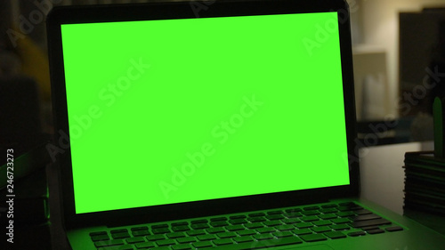 Laptop with green screen for replacement with blur background - 246723273
