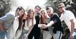 Leinwandbild Motiv group of friends takes a selfie on the background of the city Park