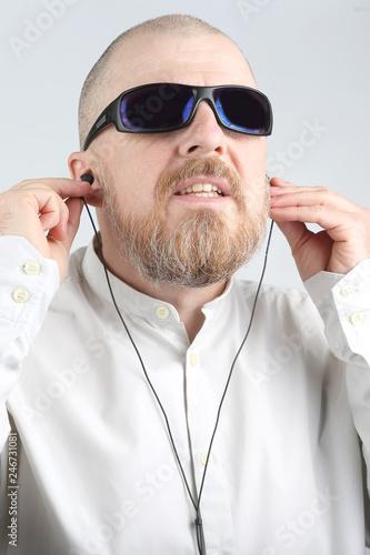 bearded man in headphones listens to music - 246731081