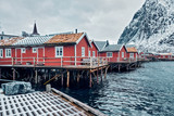 Traditional red rorbu houses in Reine, Norway - 246767609