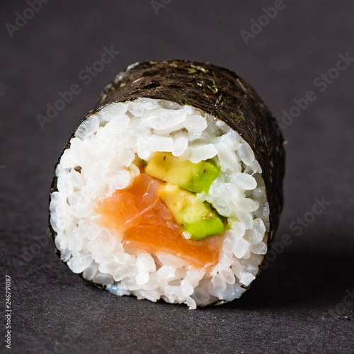 Sushi rolls set served on black stone slate on dark background - 246791087