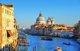 Beautiful view of Canal Grande with boats and tourists and Basilica Santa Maria della Salute in Venice,Italy