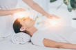 Leinwanddruck Bild - cropped shot of reiki healer doing therapy session to calm young woman with closed eyes