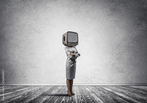 Business woman with an old TV instead of head. © adam121