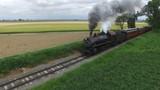 Steam Passenger Train Puffing Smoke Through Amish Countryside 1