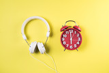 Top view red alarm clock with headphone