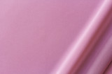 lilac fabric with large diagonal folds, textile background