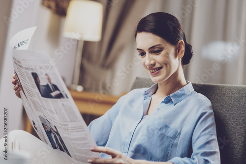Positive woman reading news reports