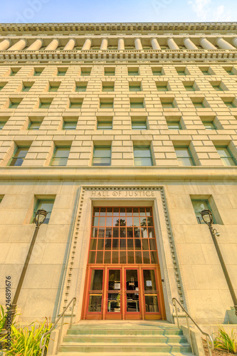Perspective view of historic building Hall of Justice, 1925. Urban cityscape. The courthouse is one of oldest surviving buildings in Los Angeles Downtown, California, United States. Vertical shot.