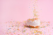 Leinwandbild Motiv Sprinkle pink donut. on a pink background with space for design. Banner
