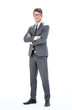 Leinwanddruck Bild - in full growth. young businessman with glasses