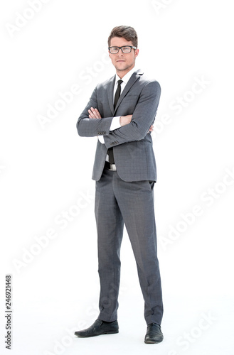Leinwanddruck Bild in full growth. young businessman with glasses