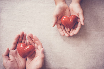 hands and red heart, health insurance, donation and charity concept