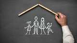 Concept For Family Insurance with Hand Drawn Chalk Illustrations On Blackboard