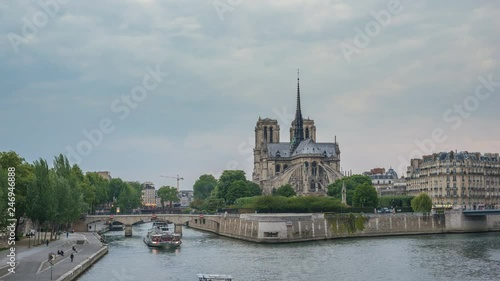Paris France time lapse 4K, city skyline day to night timelapse at Notre Dame de Paris Cathedral and Seine River
