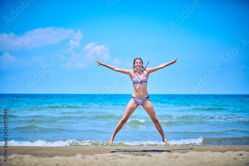 Happy Girl having fun on tropical beach - 246959449