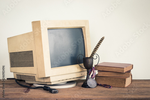 still photography : old computer monitor with trophy medal and old book on old wooden table © reshoot