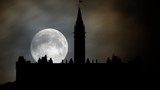 Parliament Hill (Colline du Parlement) and Its Gothic revival suite of Buildings in Silhouette by Night With Full Moon, Ottawa, Ontario, Canada - 246985882