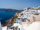 Greece. Breathtaking beautiful landscape of houses and fascinating blue water in village on Santorini Greek island in Aegean sea. June, 2018