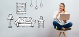 New apartment dream with young woman using her laptop on a grey background - 247004082
