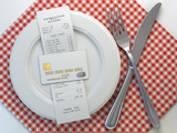 Restaurant  receipt bill  for payment by credit card on the plate, Mock up. - 247008813