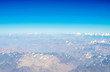 Mountains earth from aircraft under blue sky - 247010860