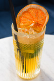 grapefruit lemonade glass with a straw