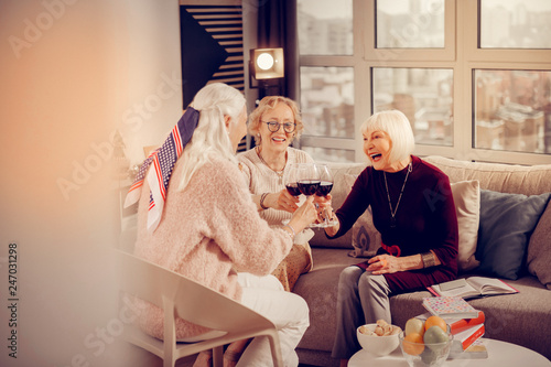 Foto Murales Happy delighted aged women meeting at home